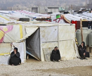 Syrian refugees women sitting outside their tents, during the visit of Filippo Grandi, the United Nations High Commissioner for Refugees, UNHCR, to a camp in the town of Saadnayel.