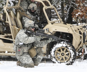 U.S. Army paratroopers assigned to 82nd Airborne Division practice a tactical halt with their brigade's new Light Tactical All Terrain Vehicle on Fort Pickett, Va., on Feb. 26, 2015.