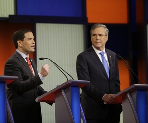 Marco Rubio makes a point as Jeb Bush listens during a Republican presidential primary debate, Thursday, Jan. 28, 2016, in Des Moines, Iowa.