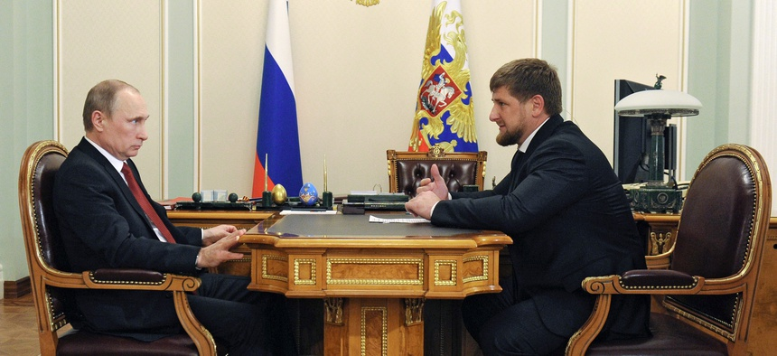 Russian President Vladimir Putin, left, listens to Chechnya's regional leader Ramzan Kadyrov during a meeting at the Novo-Ogaryovo residence outside Moscow, Russia, Monday, April 7, 2014.