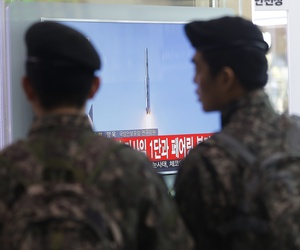 South Korean army soldiers watch a TV news program with file footage about North Korea's rocket launch at Seoul Railway Station in Seoul, South Korea, on Feb. 7, 2016.