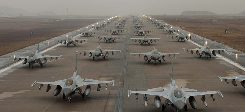 F-16 Fighting Falcons demonstrate an 'Elephant Walk' as they taxi down the flightline at Kunsan Air Base, South Korea, Dec. 14, 2012.