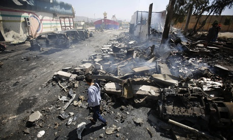 A Yemeni man inspects the site of Saudi-led airstrikes in Sanaa, Yemen, Friday, Feb. 12, 2016.