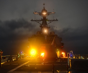 The Arleigh Burke-class guided-missile destroyer USS Lassen (DDG 82) patrols the South China Sea, Sep. 28, 2015.