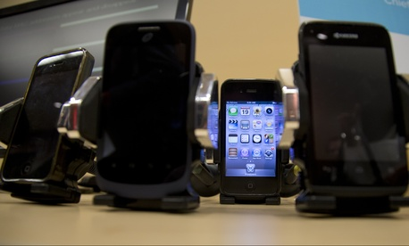 Cell phones are displayed during a Federal Trade Commission (FTC) mobile tracking demo, Wednesday, Feb. 19, 2014, in Washington.