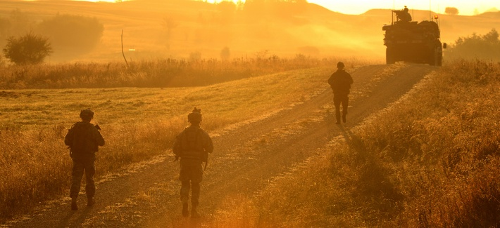 U.S. Army soldiers from the 2nd Cavalry Regiment, patrol a road at the Grafenwoehr Training Area during Exercise Saber Junction 12 in 2012.