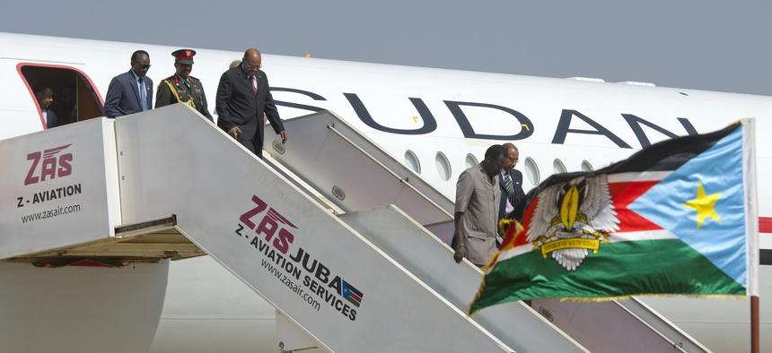 Sudan's President Omar al-Bashir, 3rd left, arrives at the airport ahead of meetings with South Sudan's President Salva Kiir, in the capital Juba, South Sudan Monday, Jan. 6, 2014.