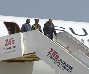 Sudan's President Omar al-Bashir, 3rd left, arrives at the airport ahead of meetings with South Sudan's President Salva Kiir, in the capital Juba, South Sudan Monday, Jan. 6, 2014.