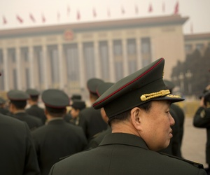 Delegates from the Chinese People's Liberation Army (PLA) arrive at the Great Hall of the People in Beijing, Friday, March 4, 2016. China said Friday it will boost military spending by about 7 to 8 percent this year, the smallest increase in six years.