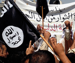 Demonstrators chant pro-Islamic State slogans as they wave the group's flags 16 June 2014 in front of the provincial government headquarters in Mosul, Iraq.