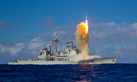 The cruiser Lake Erie, the Aegis Ballistic Missile Defense (BMD) test ship, fires a Standard missile.