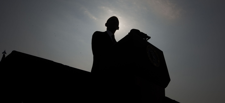 President Barack Obama is silhouetted as he speaks on stage at the Pentagon Memorial, Wednesday, Sept. 11, 2013, in Washington, to mark the 12th anniversary of the 9/11 attacks.