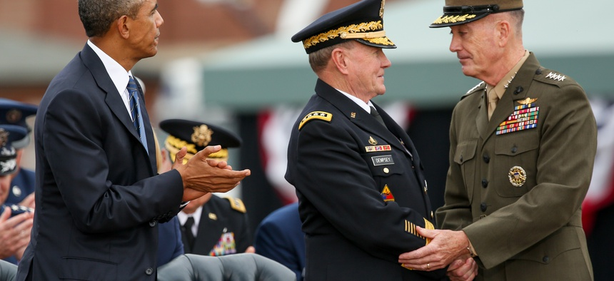 President Barack Obama watches as newly sworn-in Joint Chiefs Chairman Gen. Joseph Dunford Jr., right, shakes hands with retiring Joint Chiefs Chairman Gen. Martin Dempsey during his Armed Forces Full Honors Retirement Ceremony for Dempsey, Friday, Sept.