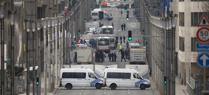 Emergency services and police work around a metro station after an explosion in Brussels on Tuesday, March 22, 2016.