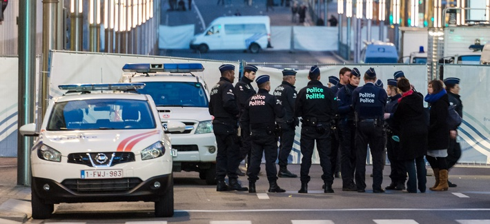 Police stand outside a metro station after an explosion in Brussels on Tuesday, March 22, 2016.