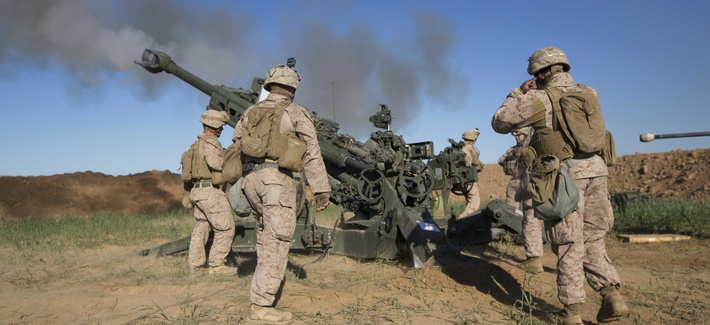 U.S. Marines with Task Force Spartan, 26th Marine Expeditionary Unit (MEU), on Fire Base Bell, Iraq, fire an M777A2 Howitzer at an ISIS infiltration route March 18, 2016.