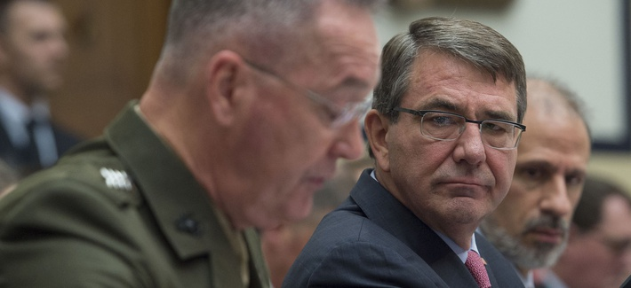 Defense Secretary Ash Carter listens as chairman of the Joint Chiefs of Staff Gen. Joseph Dunford testifies before the House Armed Services Committee on March 22, 2016.