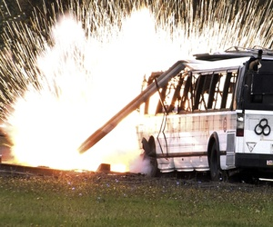 "In this photo made from video a simulated radioactive ""dirty bombs"" explodes on a bus which was used to test the ability of federal and local agencies to deal with a real terrorist attack Tuesday, Oct 16, 2007, in Portland, Ore."