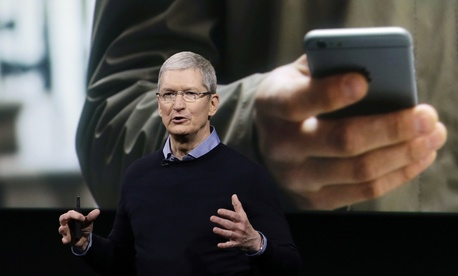 Apple CEO Tim Cook speaks at an event to announce new products at Apple headquarters, Monday, March 21, 2016, in Cupertino, Calif.