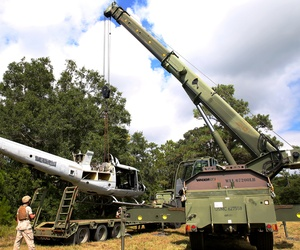 U.S. Marines use a Terex-Demag MAC-50 crane to lifts a UH-1N Huey helicopter during training at Marine Corps Base Camp Lejeune, N.C., in 2014.