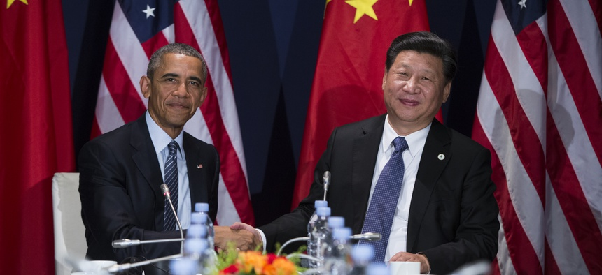 President Barack Obama, left, meets with Chinese President Xi Jinping during the COP21, United Nations Climate Change Conference, in Le Bourget, outside Paris, on Monday, Nov. 30, 2015.