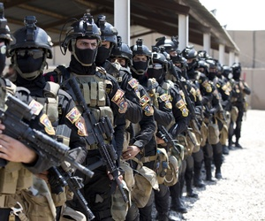 The Iraqi Counter Terrorism Service forces participate in a training exercise as U.S. Defense Secretary Ash Carter observes at its academy on the Baghdad Airport Complex in Baghdad, Iraq, Thursday, July 23, 2015.