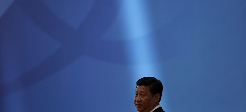 Chinese President Xi Jinping waits for leaders to arrive before a ceremony in Shanghai Wednesday, May 21, 2014.