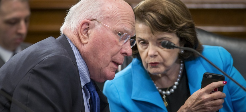Sen. Patrick Leahy, D-Vt., the ranking member of the Senate Judiciary Committee, left, speaks with Sen. Dianne Feinstein, D-Calif., on Capitol Hill in Washington, March 10, 2016.