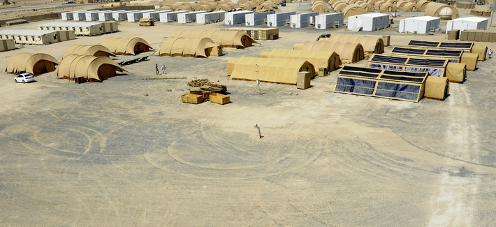 Tents being used in the research project illustrate the different technologies being used at an undisclosed location, Aug. 15, 2013.