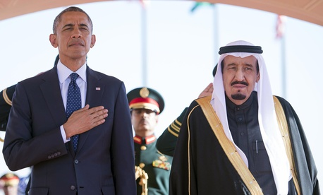 In this Tuesday, Jan. 27, 2015 photo provided by the Saudi Press Agency, President Barack Obama and Saudi Arabian King Salman bin Abdul Aziz stand during the arrival ceremony in Riyadh, Saudi Arabia, Tuesday, Jan. 27, 2015.