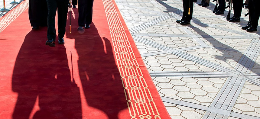 President Barack Obama and King Salman bin Abdulaziz of Saudi Arabia walk along the red carpet at King Khalid International Airport in Riyadh, Saudi Arabia, Jan. 27, 2015.