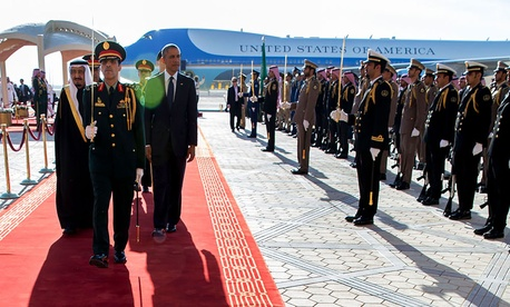 President Barack Obama and King Salman bin Abdulaziz of Saudi Arabia walk along the red carpet at King Khalid International Airport in Riyadh, Saudi Arabia, Jan. 27, 2015.