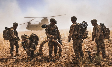 Soldiers of the 82nd Airborne Division prepare to board a CH-47F Chinook in the Nawa Valley, Kandahar Province, Afghanistan, May 25, 2014.
