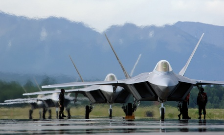 Lockheed Martin F-22 Raptors line up on a runway in 2006.