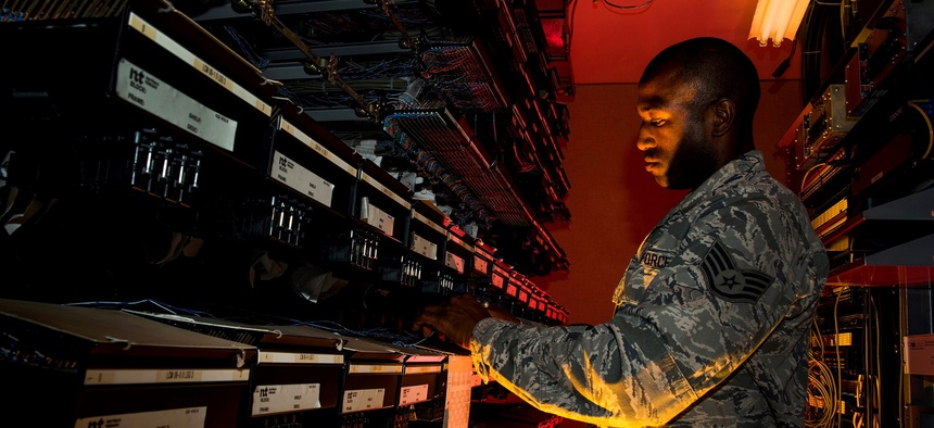A U.S. Air Force cyber transport systems technician at work Aug. 8, 2013, at Joint Base Charleston, S.C.
