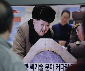 People watch a TV screen showing North Korean leader Kim Jong Un during a news program, at Seoul Railway Station in Seoul, South Korea, Tuesday, March 15, 2016.
