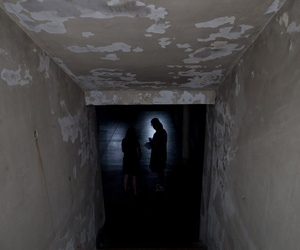 Women stand inside the basement that served as an admitting area for detainees at the former torture and killing center known as the Argentine Navy School of Mechanics, in Buenos Aires, Argentina, March 16, 2016.