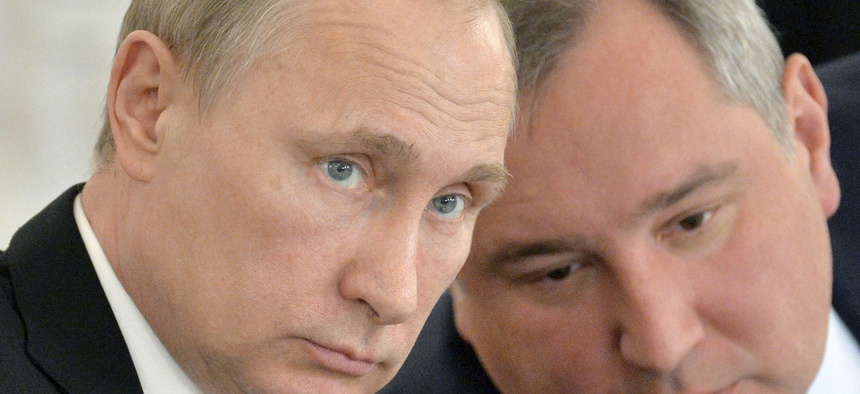Russian President Vladimir Putin, left, and his defense czar Dmitry Rogozin at the Kremlin last year.