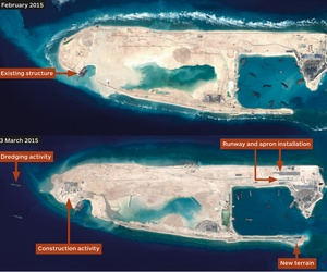 A combination photo of satellite images of Fiery Cross Reef in the Spratly Islands, taken on Feb. 6, 2015, top, and March 23, 2015, bottom, by Airbus Defence and Space, and distributed by IHS Jane's Defence Weekly.