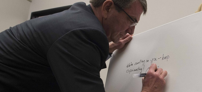 Secretary of Defense Ash Carter signs the guest board at Galvanize San Francisco, March 1, 2016.