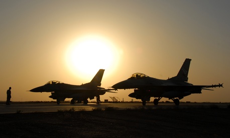 A pair of Air Force F-16 Fighting Falcons sit on the flight line at Balad Air Base in Iraq at sunset in 2007.
