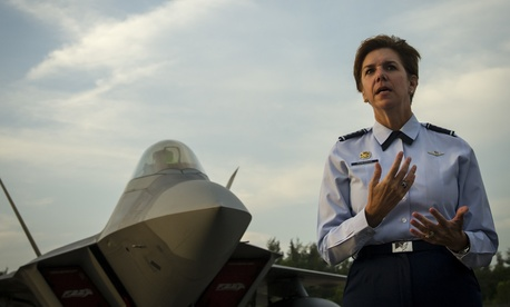 Gen. Lori Robinson, then-Pacific Air Forces commander, addresses U.S. and Singapore Airmen in front of an F-22A Raptor during the Singapore International Airshow, at Changi International Airport, Singapore, Feb. 17, 2016.