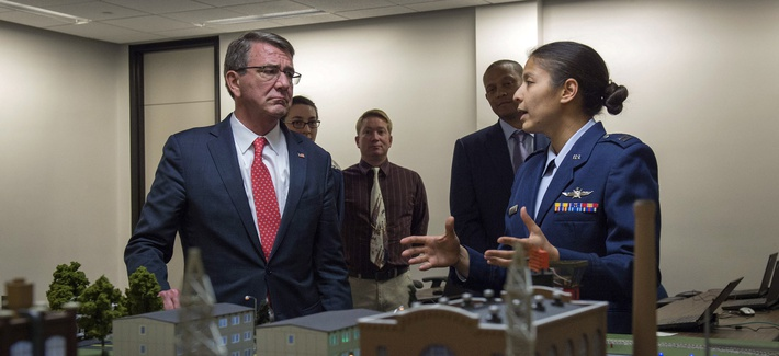 Secretary of Defense Ash Carter is briefed on some of the curriculum taught at the Air Force Academy as he tours the campus in Colorado Springs, Colo., May 12, 2016.