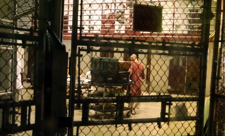 In this Feb. 2, 2016 photo, a detainee is seen in the communal area inside Camp 6 in the U.S. detention center at Guantanamo Bay, Cuba.