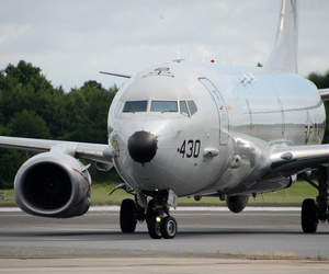 A U.S. Navy P-8A Poseidon touches down in Jacksonville, Fla.