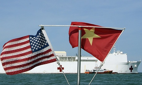 U.S. and Vietnamese flags fly in unison as the Military Sealift Command hospital ship USNS Mercy (T-AH 19) sits on station in the Gulf of Tonkin, July 13, 2012.