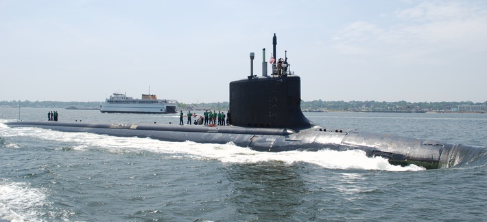 The Virginia-class attack submarine USS New Mexico transits the Thames River to her new home port at Naval Submarine Base New London, Connecticut, in June 2010.