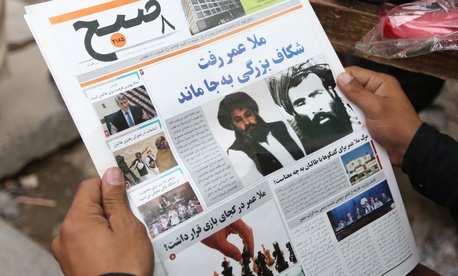 An Afghan local newspaper with photos of then-new leader of the Afghan Taliban, Mullah Akhtar Mansoor, center, and former leader Mullah Mohammad Omar, from Aug. 1, 2015.