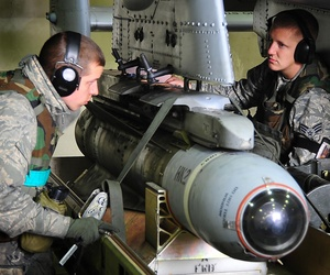 A weapons loading team from the 25th Fighter Squadron, loads bombs on an A-10 Warthog at Osan Air Base, South Korea.