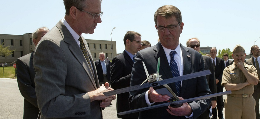 Secretary of Defense Ash Carter examines an unmanned aerial vehicle during a visit to the Naval Undersea Warfare Center Newport in Newport, R.I., May 25, 2016